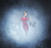 Young woman in fashion dress over glamour background Royalty Free Stock Photography