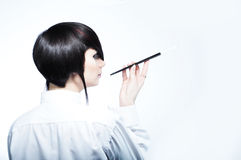 Young woman with fashion haircut holding a cigaret Royalty Free Stock Photography