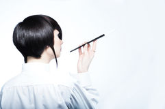 Young woman with fashion haircut holding a cigaret Royalty Free Stock Photo
