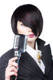 Young woman with fashion haircut holding a vintage Royalty Free Stock Images