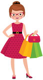 Young woman of fashion holding shopping bags Stock Photography