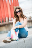 young woman with fashion magazine stock photography