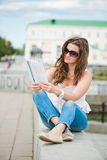 Young woman with fashion magazine royalty free stock photos