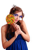 Young woman with fashion make-up. Beautiful young woman with fashion make-up hold big lollipop, isolated on white Royalty Free Stock Photography