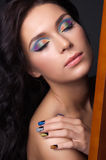 Young woman with fashion make-up and manicure Stock Image