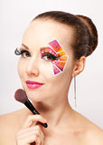 Young woman with fashion makeup using false eyelashes Royalty Free Stock Photo