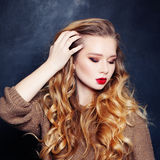 Young Woman Fashion Mode with Curly Blonde Hair. Style Royalty Free Stock Images