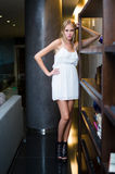 Young Woman Fashion Model in white dress. Standing Stock Image