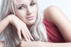 Young woman fashion portrait. Soft white colors royalty free stock image