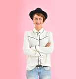 Young woman in fashionable clothes wearing black hat Royalty Free Stock Image