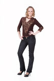 Young Woman In Fashionable Clothing. Young attractive woman in fashionable clothing on isolated background Stock Photography