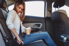 Young woman fastens a seat belt stock photos