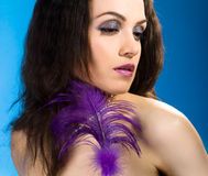 Young woman with feather Stock Photos
