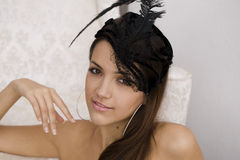 Young woman in feather headdress. Stock Image