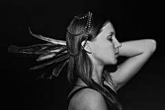 Young woman with feathers Royalty Free Stock Photos