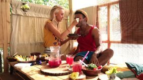 Young woman feeding her lover with healthy food stock video