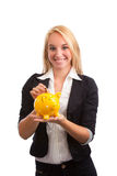 Young woman feeding piggy bank Stock Photography