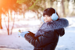 Young woman feeding winter birds Winter woman on background of w Royalty Free Stock Images