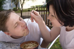 The young woman feeds her husband Royalty Free Stock Image