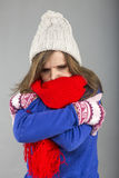 Young woman feeling cold  trying to keep warm, shaking and shive Stock Photography