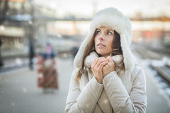 Young woman feeling cold in winter day Stock Images