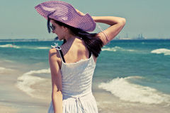 Young woman feeling happy on beach Royalty Free Stock Photo