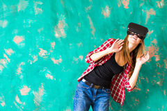 Young Woman feeling shocking for using the virtual reality device Royalty Free Stock Photo