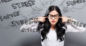 Young woman feeling stressed. On a gray background Royalty Free Stock Photography