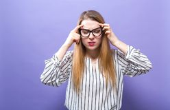 Young woman feeling stressed. On a solid background Stock Photography