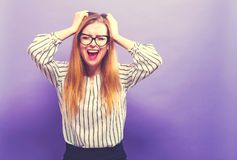 Young woman feeling stressed. On a solid background Royalty Free Stock Photography