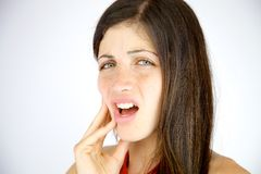 Young woman feeling strong teeth pain Stock Photos