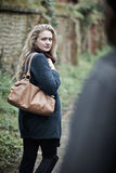 Young Woman Feeling Threatened As She Walks Home. Woman Feeling Threatened As She Walks Home Royalty Free Stock Images