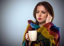 Young woman feeling unwell Stock Photo