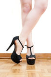Young woman feet with black high heels and legs Royalty Free Stock Image