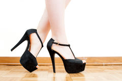 Young woman feet with black high heels and legs Stock Images