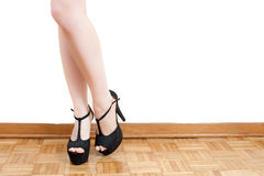 Young woman feet with black high heels and legs Stock Photos