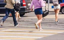 Young woman feet running an urban street stock photo