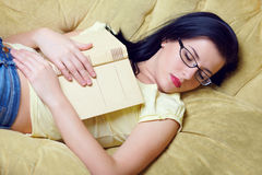 Young woman fell asleep after reading book Royalty Free Stock Images