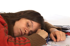 Young Woman Fell Asleep While Writing. Young Caucasian woman fell asleep while writing and studying. Isolated on white (Selective Focus, Focus on the right eye Stock Image