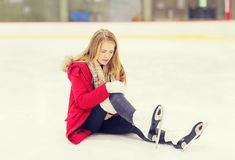 Young woman fell down on skating rink Royalty Free Stock Photography