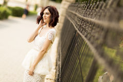 Young woman by the fence Royalty Free Stock Images