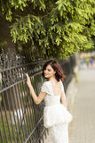 Young woman by the fence Royalty Free Stock Image