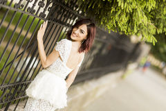 Young woman by the fence Stock Photos