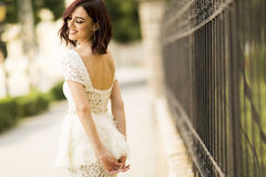 Young woman by the fence Royalty Free Stock Photo