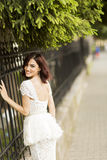 Young woman by the fence Stock Images