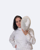 Young woman in fencing jacket with mask. Young woman holding fencing mask in jacket Stock Image