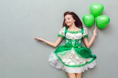Young woman in a festive dress saint patrick`s day top view royalty free stock images