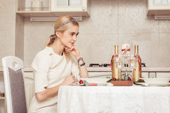 Young woman at festive table Royalty Free Stock Photography