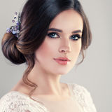 Young Woman Fiancee with Bridal Hairstyle. Natural Makeup and Jewelry Royalty Free Stock Images