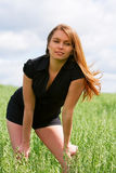 Young woman in a field. Royalty Free Stock Photo